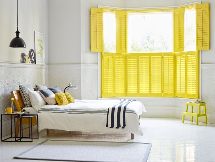 bold yellow tier on tier shutters