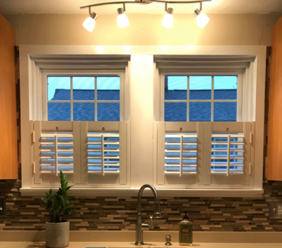 double-hung-window-with-cafe-style-shutters-fitted.png