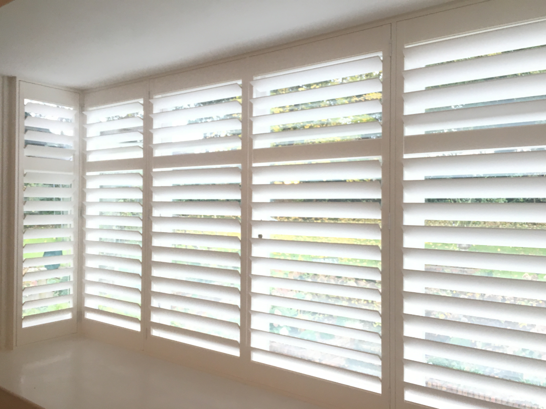 4-5-shutter-slats-beautiful-on-large-bay-window.png