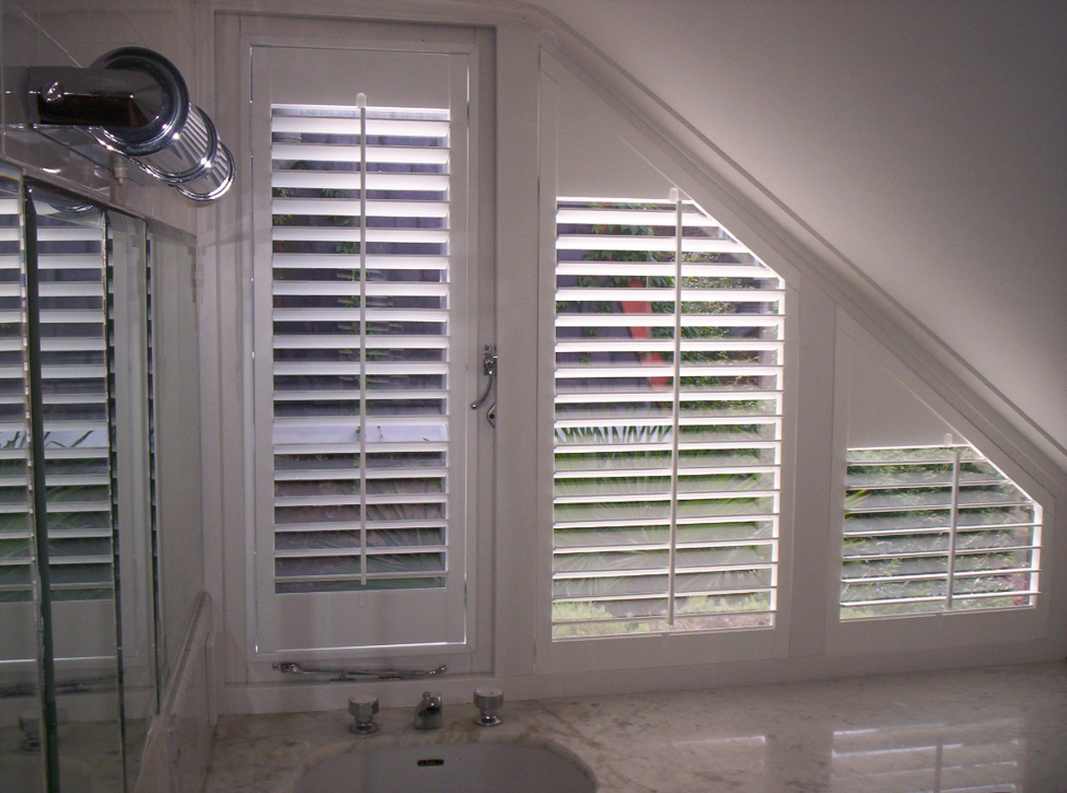 slanted-shaped-window-with-shutters-in-the-bathroom.png