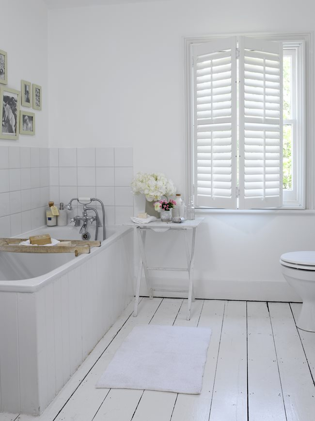 white shutters brightening up the bathroom