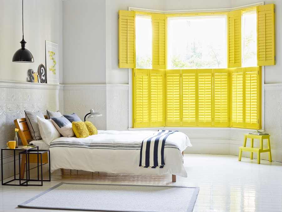 yellow-tier-on-tier-shutters-insulating-bedroom.jpg