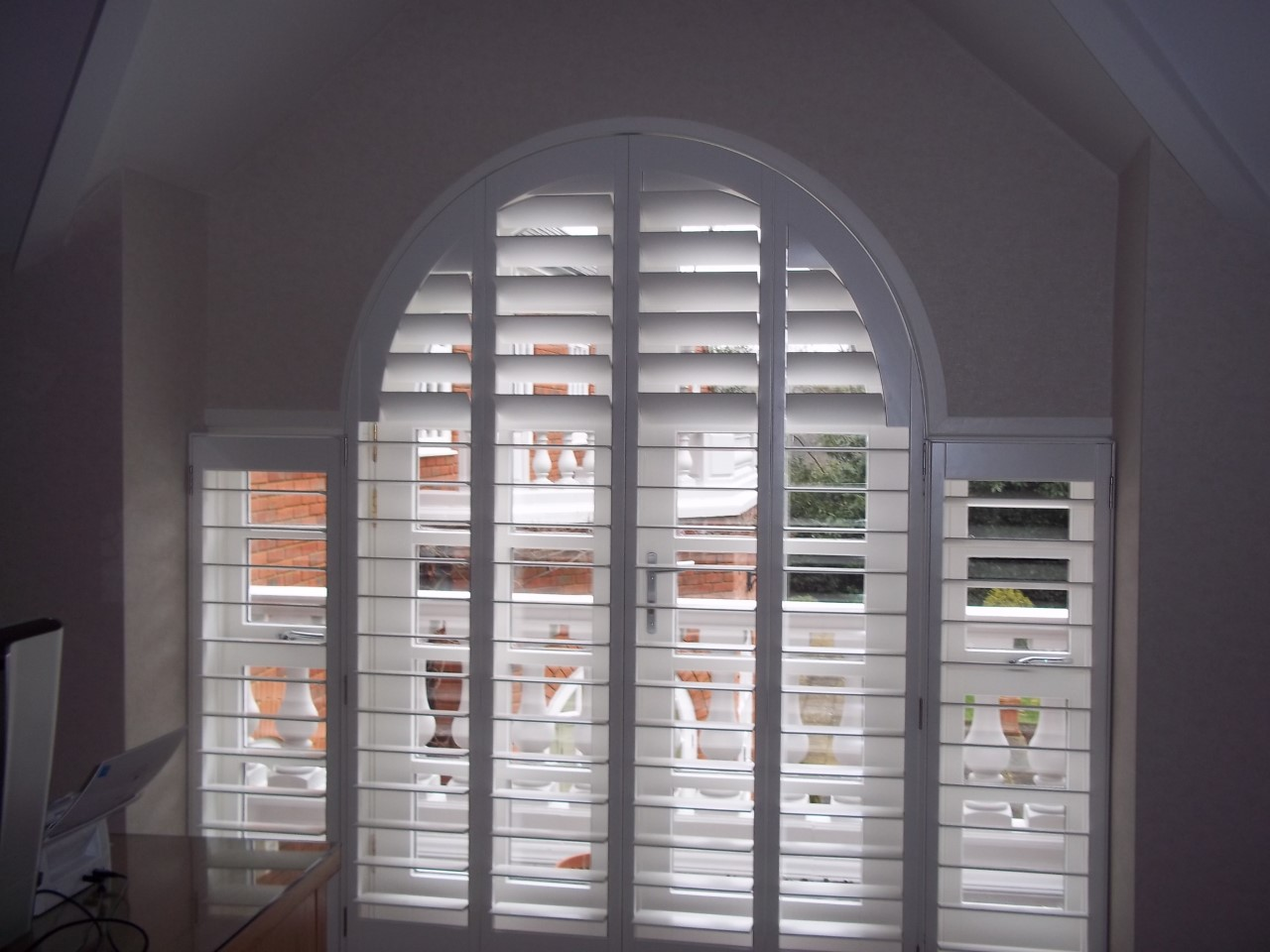 plantation-shutters-perfect-for-any-living-room-window.png