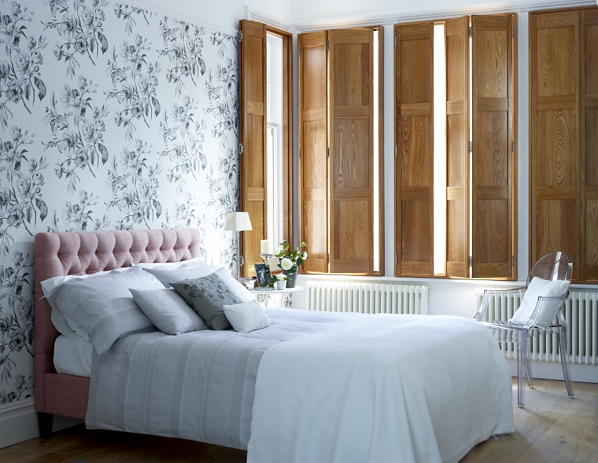 beautiful-solid-panel-wooden-shutters-in-bedroom.jpg