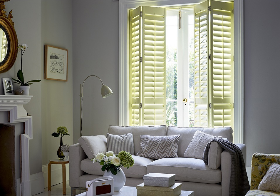 yellow-shade-full-length-shutters-in-the-living-room.png