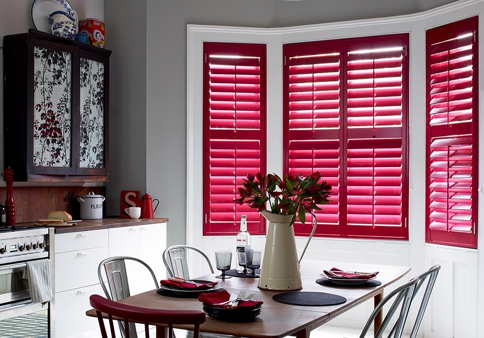 Wide slat plantation shutters with a custom red shade