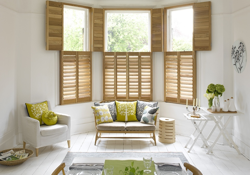 Natural wood stained shutters in tier on tier style