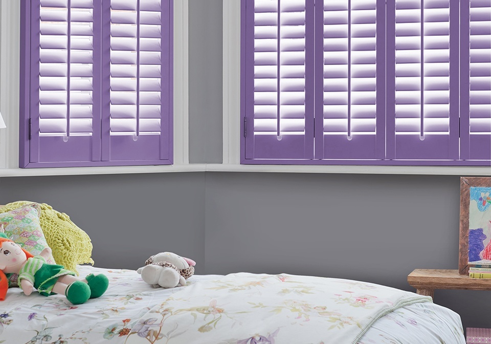 Custom coloured full height shutters in a childs bedroom.