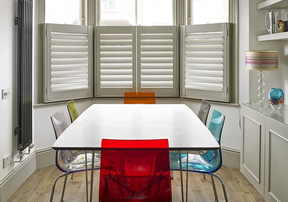 Café Style Shutters In The Dining Area Of This Modern Kitchen