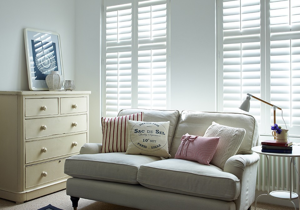 Subtle bright white shutters inside mounted to recess.