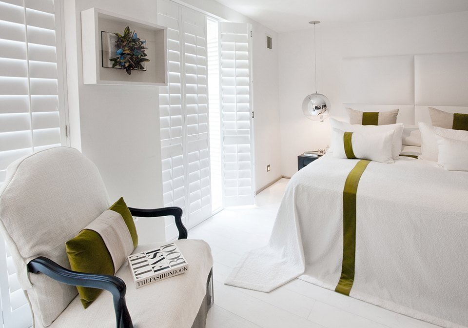 White shutters in a modern bedroom.