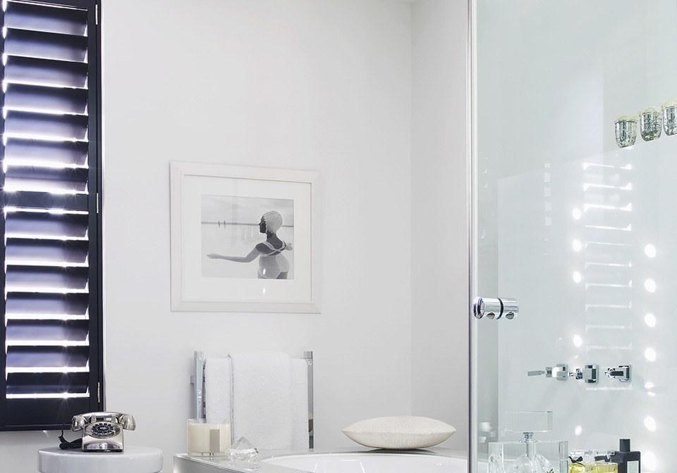 Black Designer Shutters In Contrast To White Bathroom