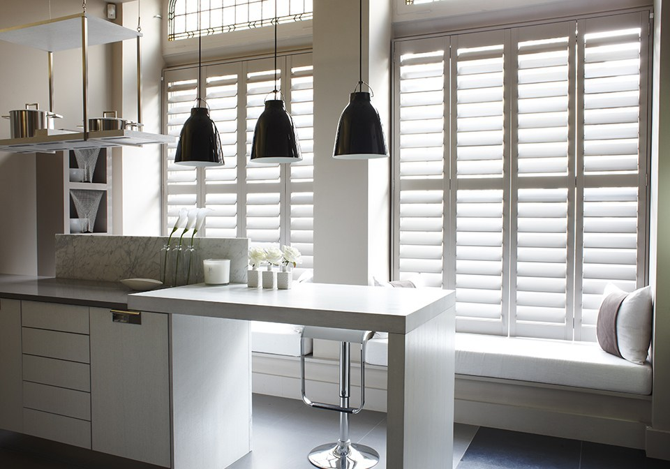 Plaster colored shutters in a modern kitchen