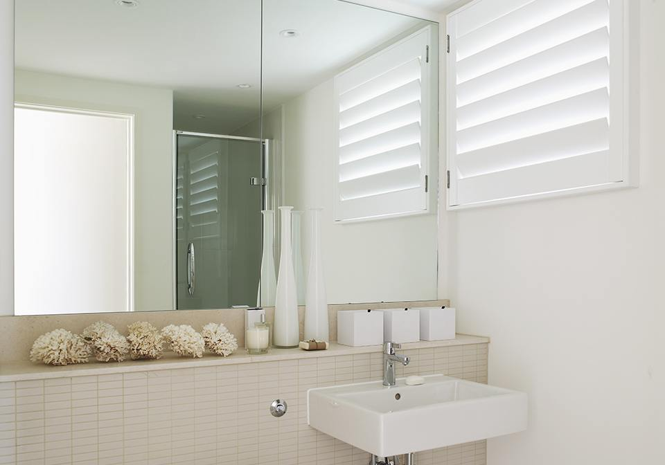 "3 1/2"" louvred shutters for a light bathroom"